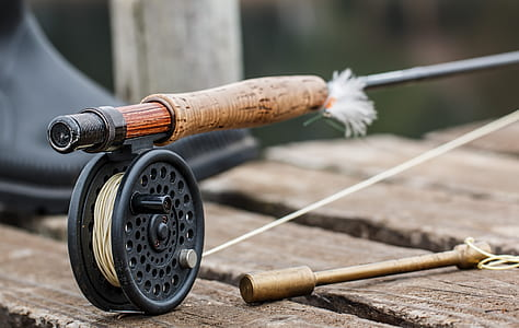 brown fishing rod with black reel