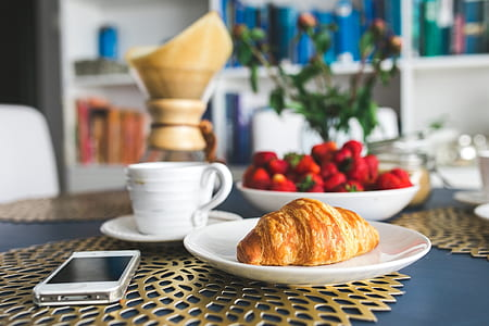 brown croissant bread on white ceramic plate