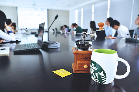 Office meeting and presentation with coffee cup