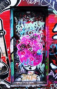 multicolored graffitti on wall