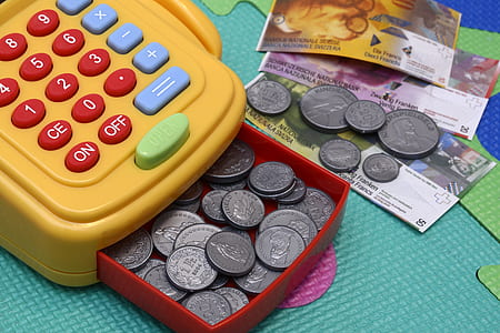 orange and red credit card terminal with coin toy