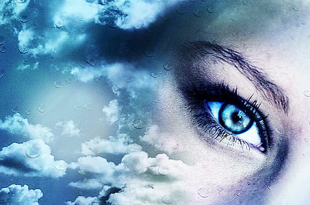 poster of woman's eye and clouds