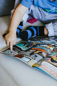 Child reading a comic story