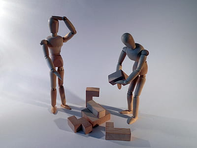 two wooden character toys