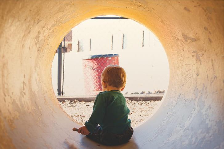 boy inside a concrete tunnel