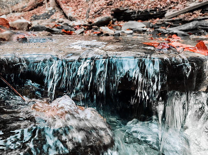 clear waterfalls with rocks