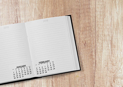 white notebook with calendar