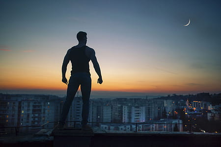 man standing and looking at the buildings