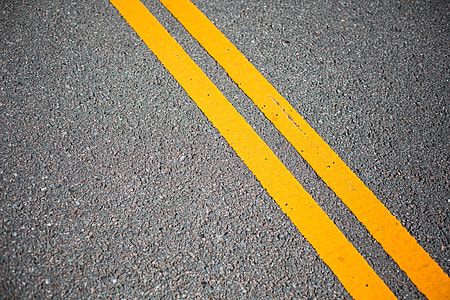 Asphalt Road with Yellow Road Lines