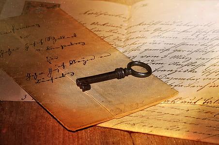 black skeleton key on brown paper