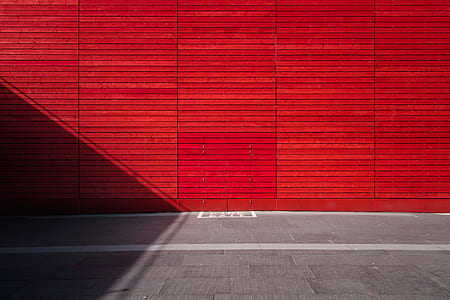 photo of red wall and gray floor