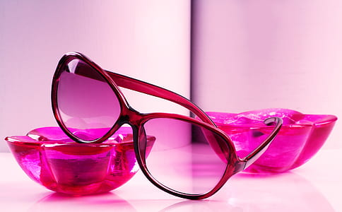 pink sunglasses with black frames