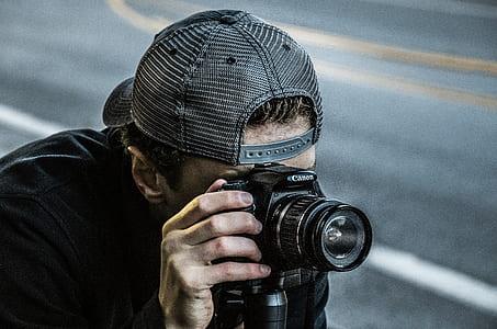Man Taking Photo Using Black Canon DSLR Camera