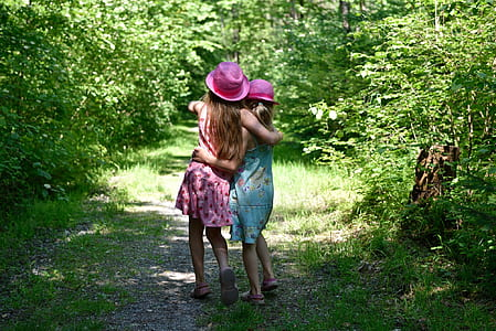 two women wearing pink hats hugging each other