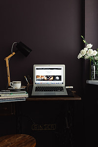 Contemporary home office idea with dark walls