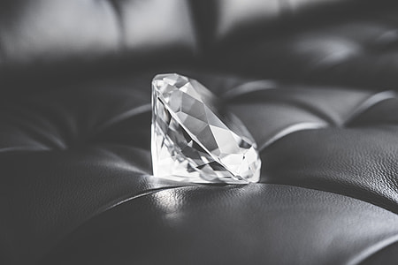 Big Glass Diamond Crystal on Black Leather Sofa