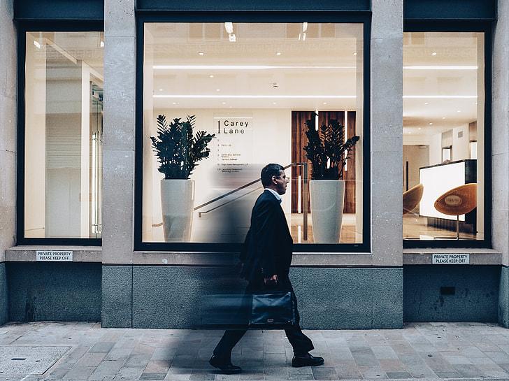 man crossing shop