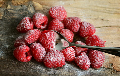 raspberries on brown surface