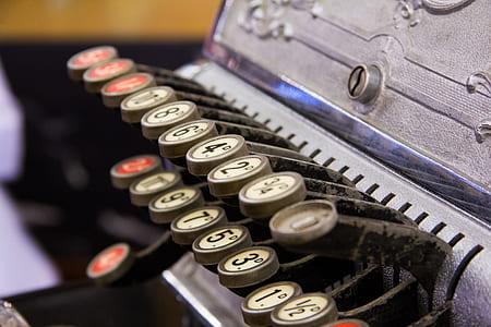 close photo of gray brail typewriter