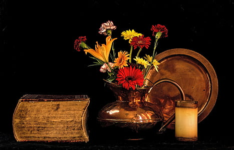 yellow and red flowers in brass teapot