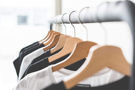 Wooden T-Shirt Hangers in Fashion Apparel Store