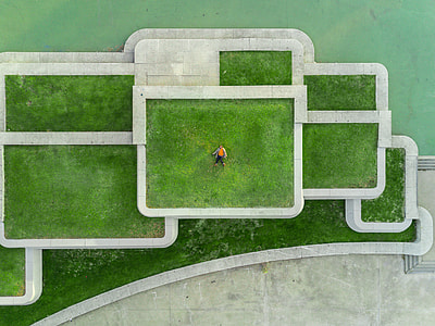 aerial photography of man lying on lawn