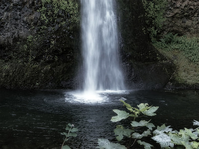 photo of waterfalls surrounded with rock