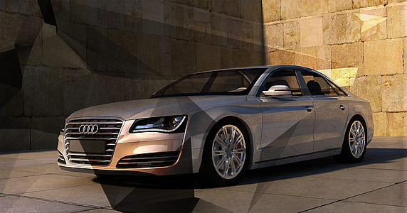 gray Audi sedan on gray floor tile