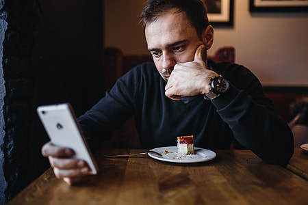 Young Elegantly dressed man sititng in a cafe
