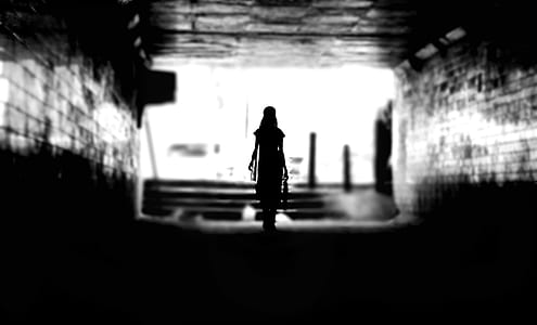 woman walking on alley
