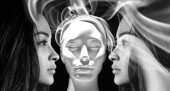 grayscale photo of woman portrait with smoke