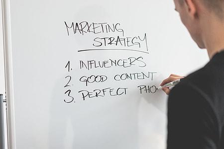 Marketing Expert Writing New Marketing Strategy on Whiteboard