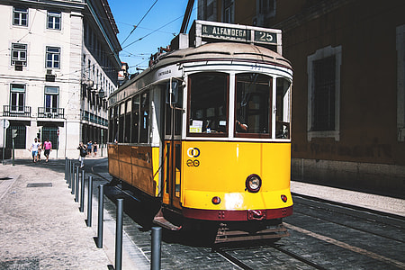 A yellow tram on the streets of Lisbon in Portugal