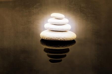 stack of four white stones