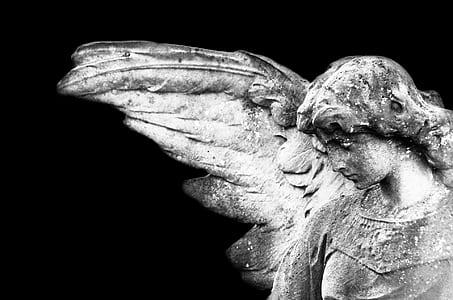 angel statue looking downward