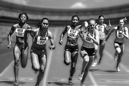six women running on field during daytime