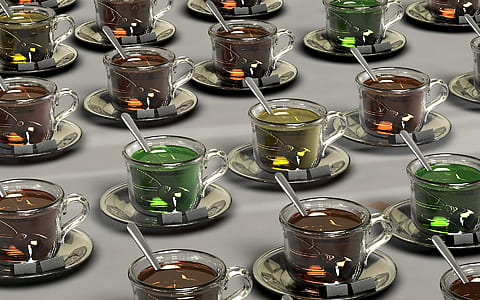 clear glass teacup with assorted-color liquid inside lot