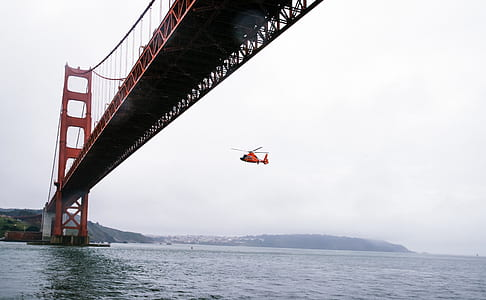 Rescue Helicopter Flying Under Golden Gate Bridge
