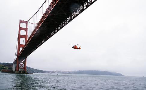 Rescue Helicopter Flying Under Golden Gate Bridge