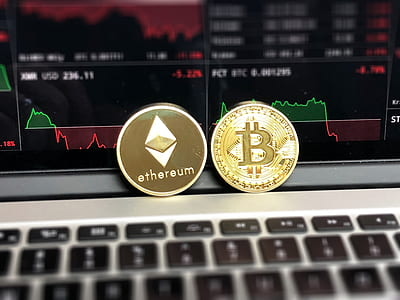 Ethereum and Bitcoin Emblems