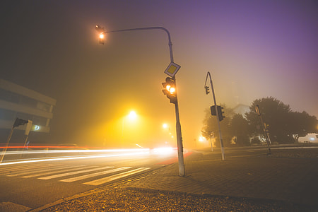 Car Lights & Crossroad Traffic Lights in The Fog