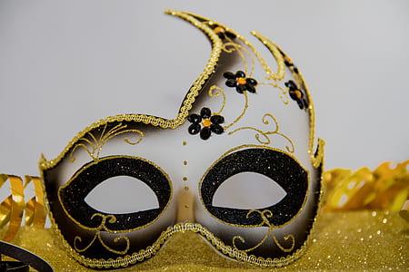 gray and gold masquerade mask