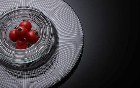Five Tomatoes on Clear Glass Bowls