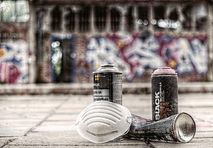 two black spray cans