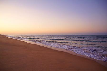 open sea near seashore at daytime