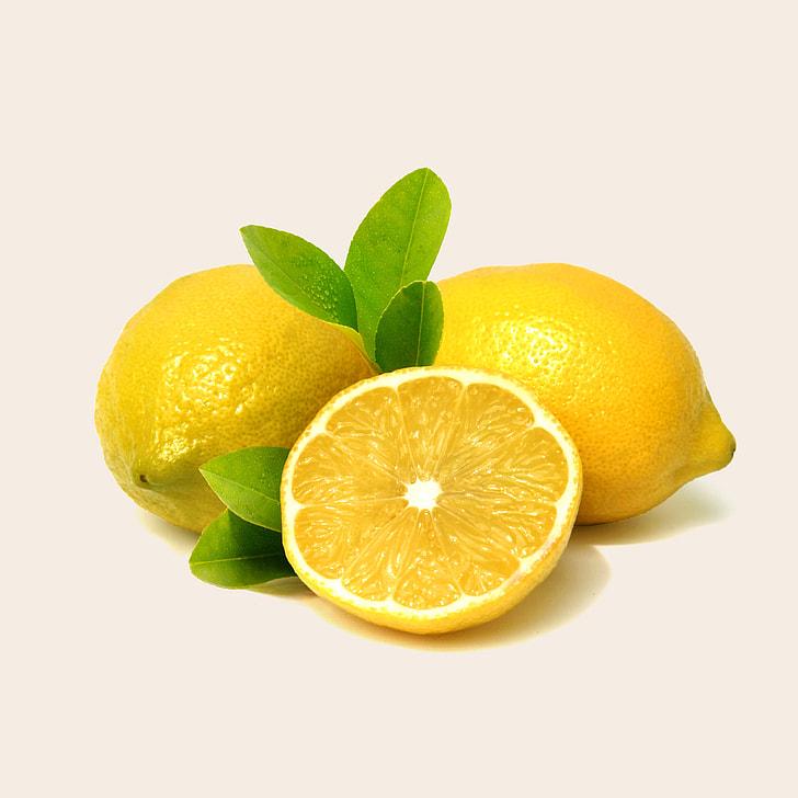 three yellow lemon fruits