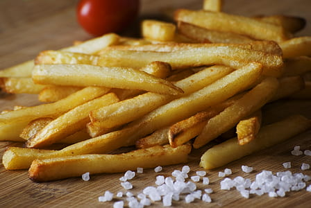 fried potato fries near salts