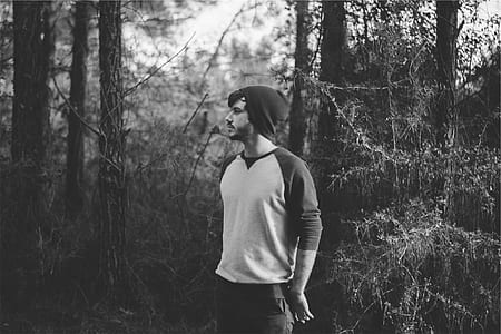 grayscale photography of man on forest