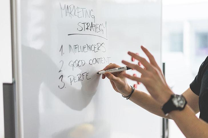 Royalty-Free photo: Marketing Expert Explaining New Marketing ...