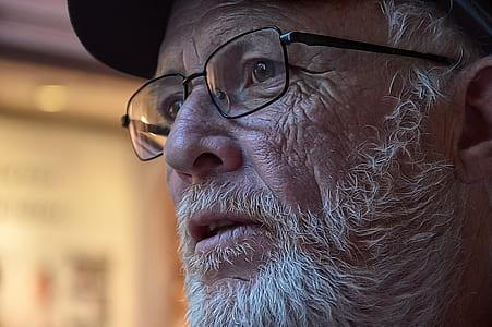 man face wearing eyeglasses
